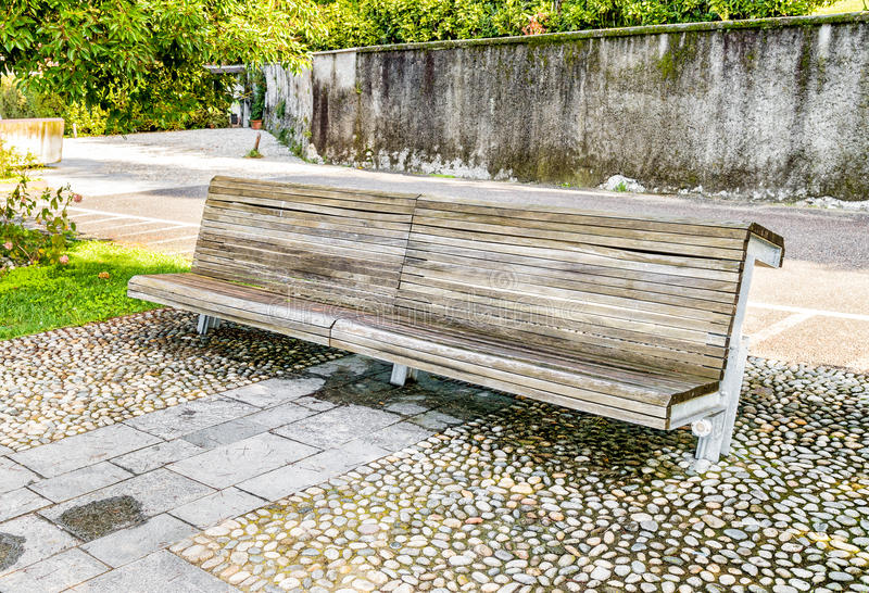Wooden bench in the autumn park stock image