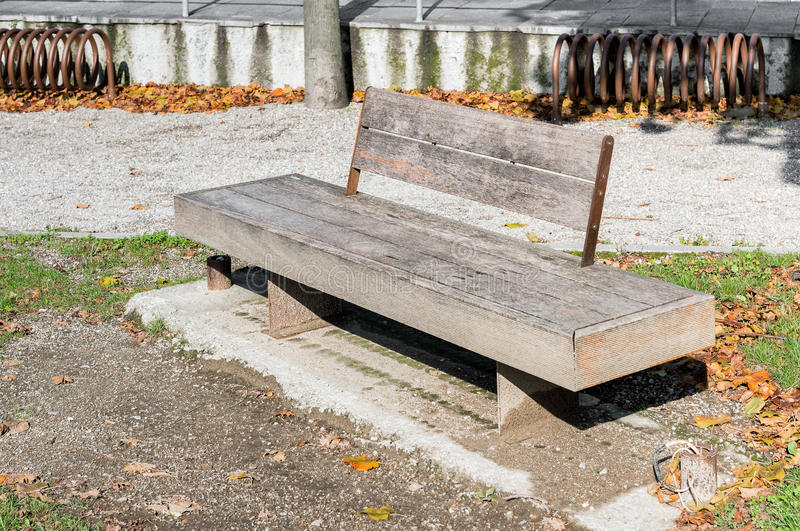 Wooden bench in the autumn park royalty free stock images