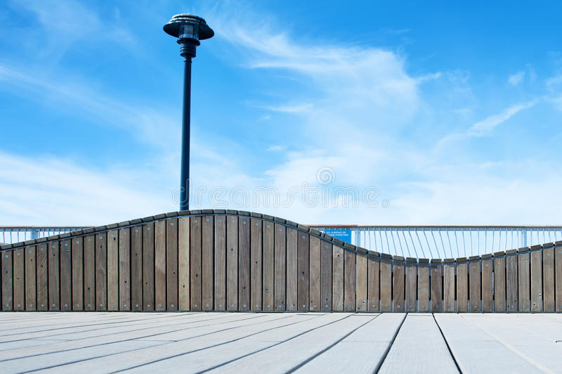 Wooden bench. Boardwalk. Intersting wooden bench with street lamp on Coney Island Boardwalk at beach stock image