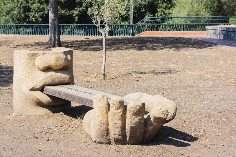 Wooden bench with concrete decoration in Park Gioeni, Catania, Sicily, Italy stock photo
