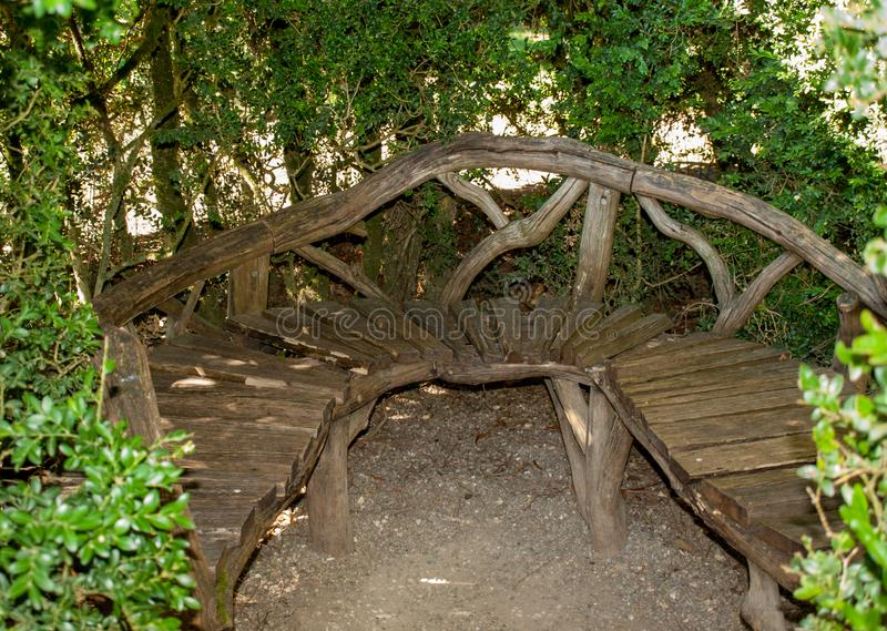 Wooden bench in the gardens of the Jardins de Marqueyssac in the Dordogne region of France. Wooden bench in the gardens of the Jardins de Marqueyssac in the stock photography