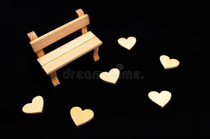 A wooden bench and hearts. A place for visiting lovers. Empty be royalty free stock photos