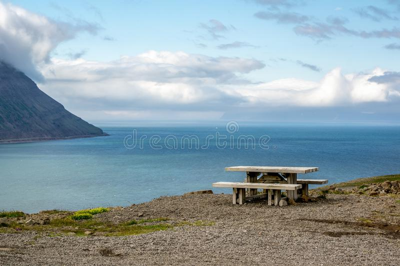 A wooden bench on a hill with beautiful outlook in Iceland. A wooden bench on a hill with beautiful outlook near the city of Sudavik in Iceland, Europe stock image