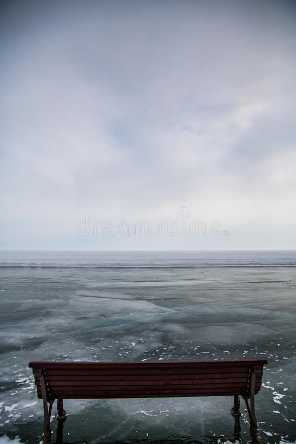 Wooden bench on the ice of Lake Baikal royalty free stock photos