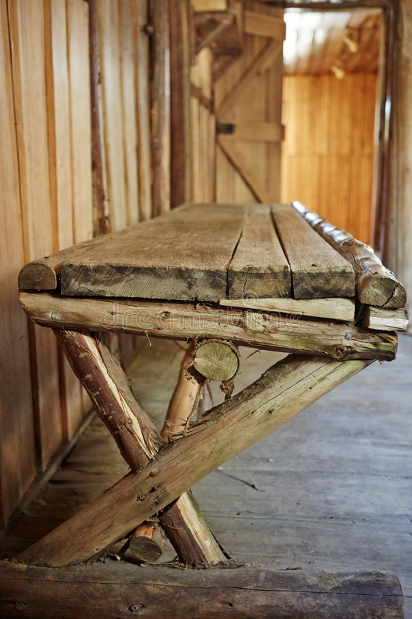 Wooden bench inside old hut stock photos