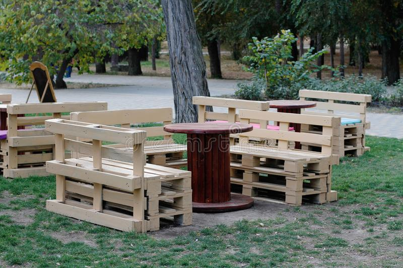 Download Wooden Bench Made Of Pallets For Sitting With Tables Made From  Coil Of Electric Cable
