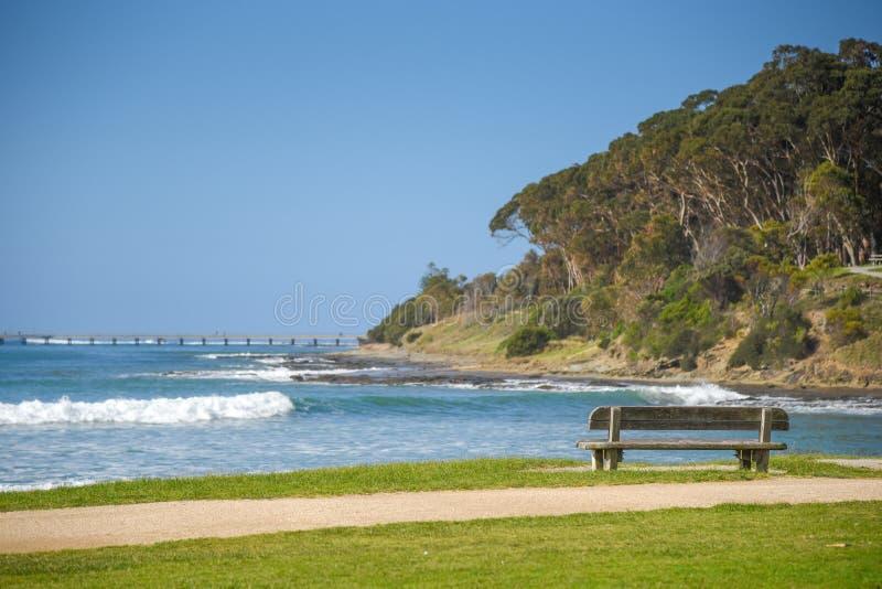 Wooden bench near beach and sea royalty free stock photos