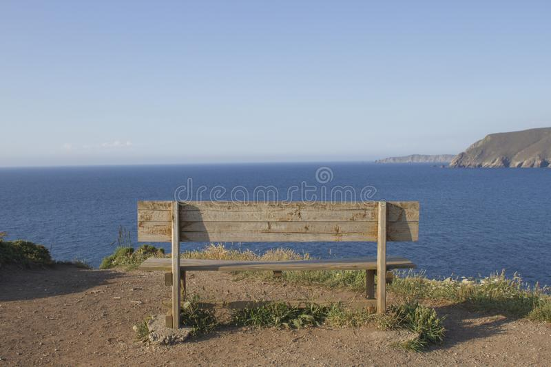 Wooden bench overlooking the sea royalty free stock image