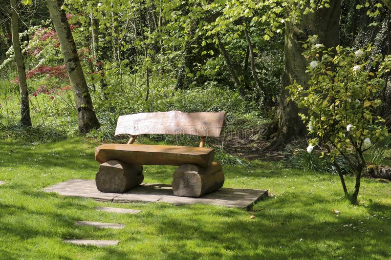 Wooden bench in the park stock photos