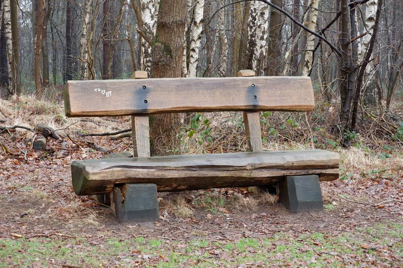 Wooden bench in park. With trees and white schratched heartn stock photos