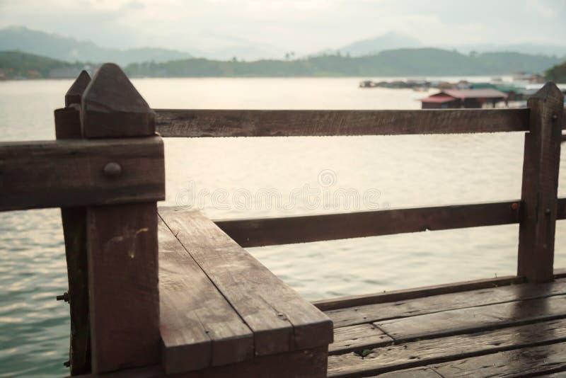 Wooden Bench Seat with beautiful natural morning sunrise over Songkalia river background on Saphan Mon Wooden Bridge Mon Bridge royalty free stock image