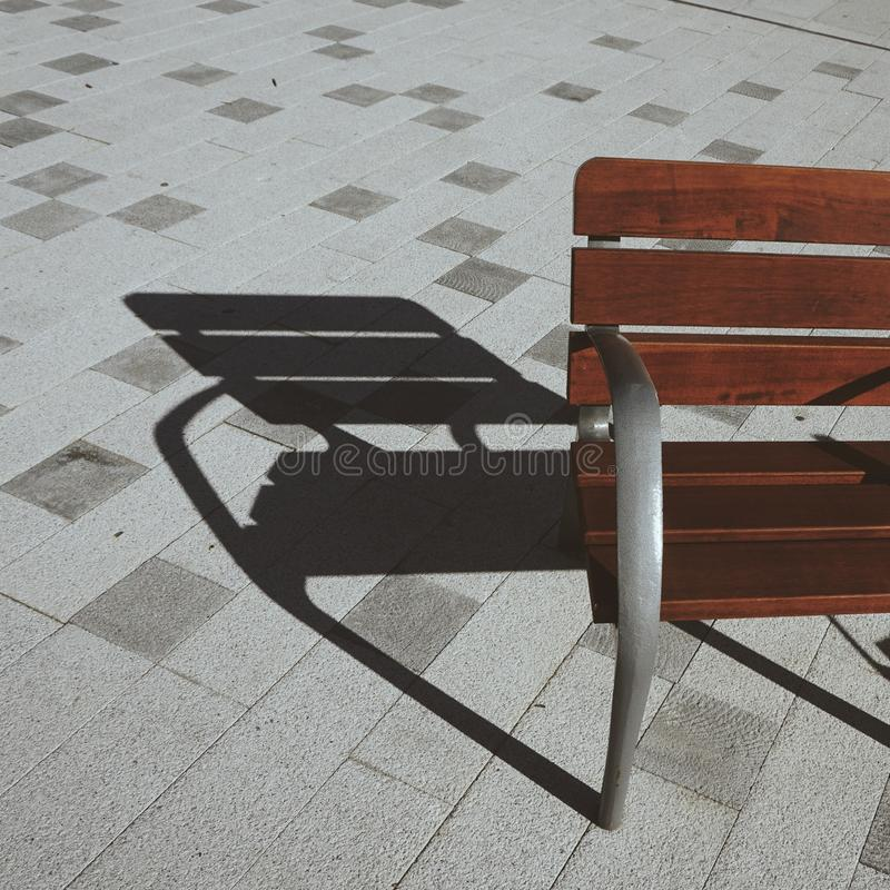 Wooden bench in the street in Bilbao city. Spain royalty free stock image