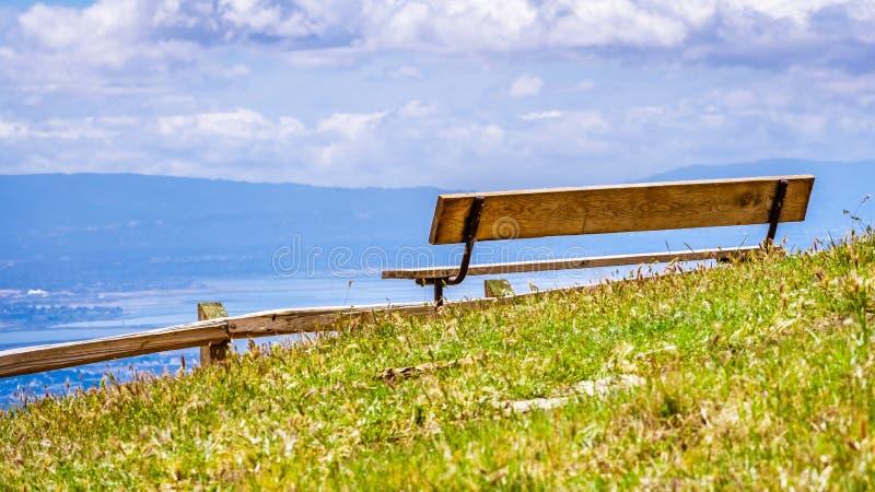 Wooden bench and vista point overlooking south San Francisco bay area and San Jose, California stock photos