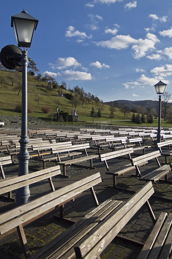 Wooden benches at marija bistrica royalty free stock images