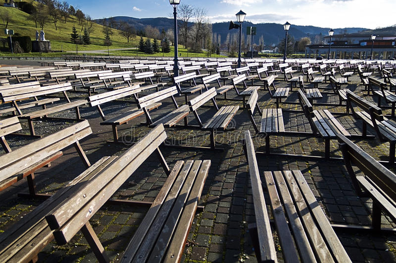 Wooden benches at marija bistrica royalty free stock photography