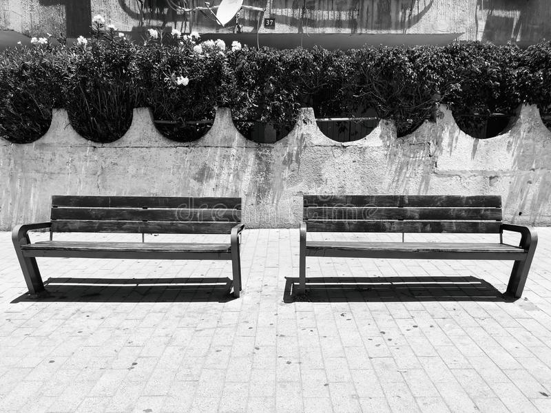Wooden benches near houses  in Rishon Le Zion, Israel. Wooden benches near houses  in Rishon Le Zion, Israel royalty free stock image