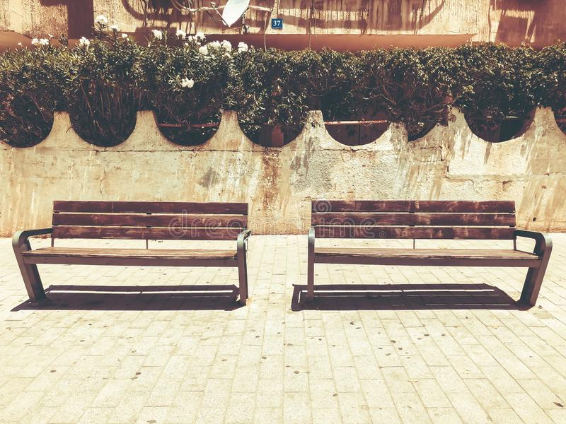 Wooden benches near houses  in Rishon Le Zion, Israel. Wooden benches near houses  in Rishon Le Zion, Israel royalty free stock photo