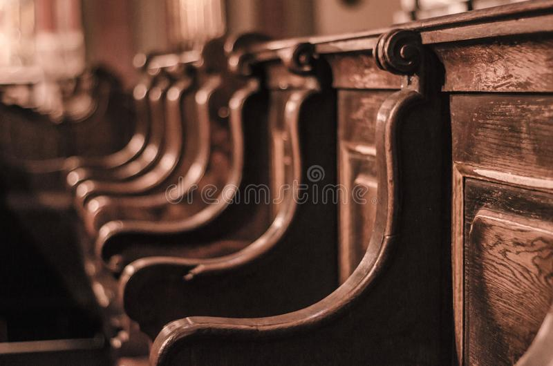 Wooden benches in the old cathedral. Baroque and Middle Ages royalty free stock photography