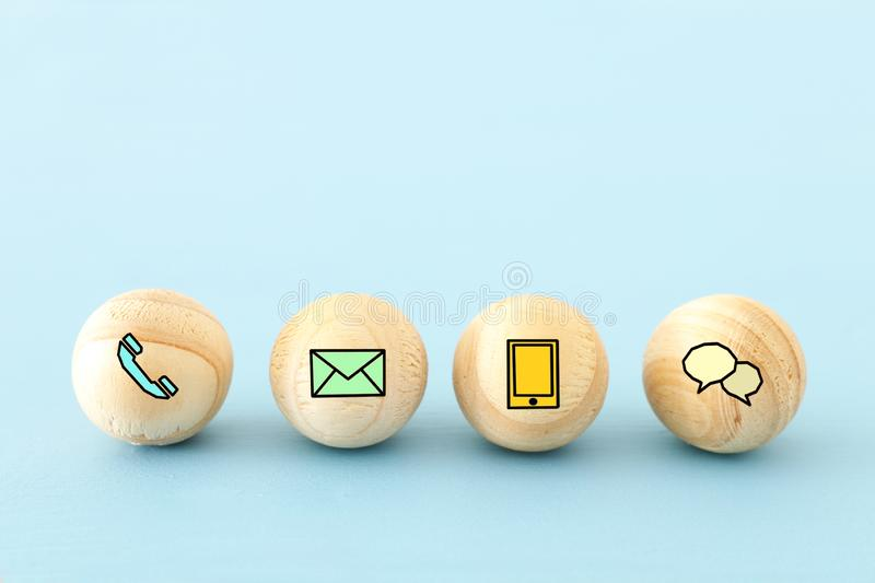 wooden bids with contact us icons. royalty free stock image