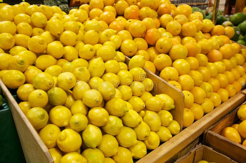 Wooden Bins Filled with Fresh Lemons and Oranges royalty free stock photo