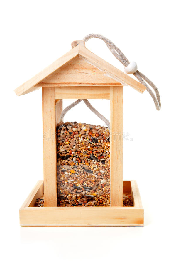 Wooden bird feeder house royalty free stock photo