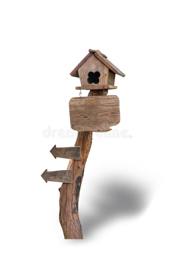 Wooden bird house on wooden sign isolated on white background royalty free stock photos