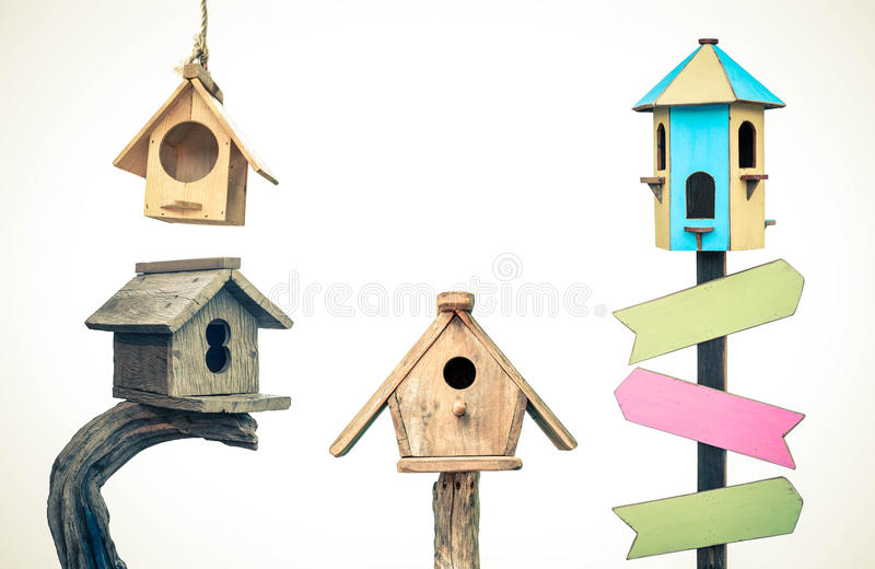Wooden bird houses. Different types of wooden bird houses isolated on white background royalty free stock images