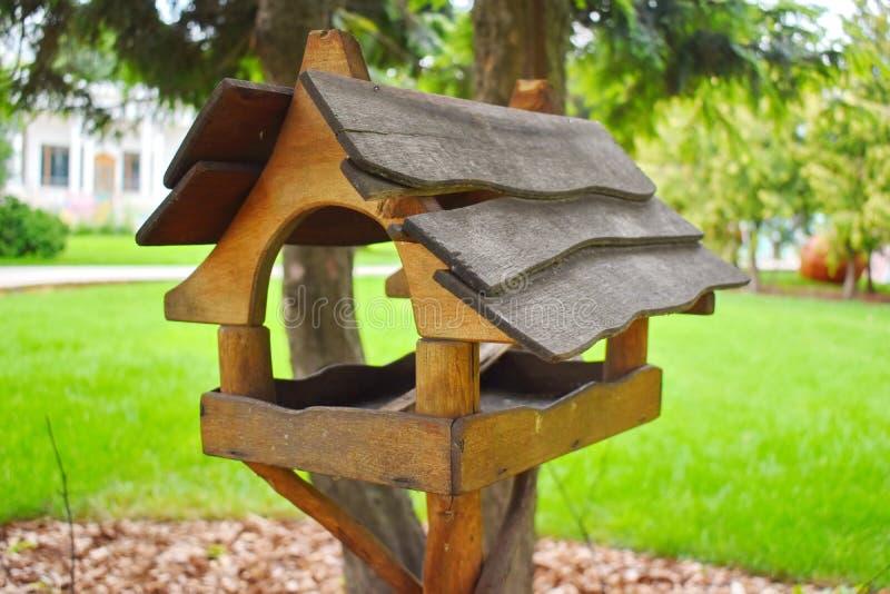 Wooden birds feeder. Garden decor handwork royalty free stock images