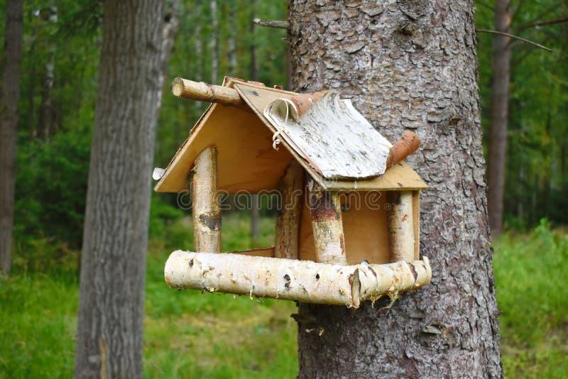 Wooden birds feeder. Garden decor handwork. stock photo