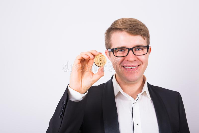 Wooden Bitcoin in funny man hand, Digital symbol of a new virtual currency.  royalty free stock photo