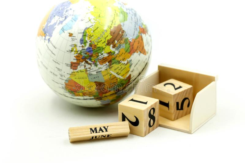 Wooden block calendar date and mounth with miniworld.  stock image