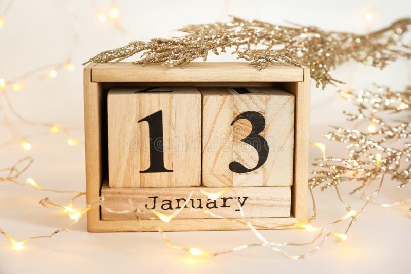 Wooden block calendar, decor and electric. Garland on table. Christmas countdown stock photos