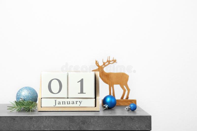Wooden block calendar and decor on table. Christmas countdown. Wooden block calendar and festive decor on table. Christmas countdown royalty free stock photos