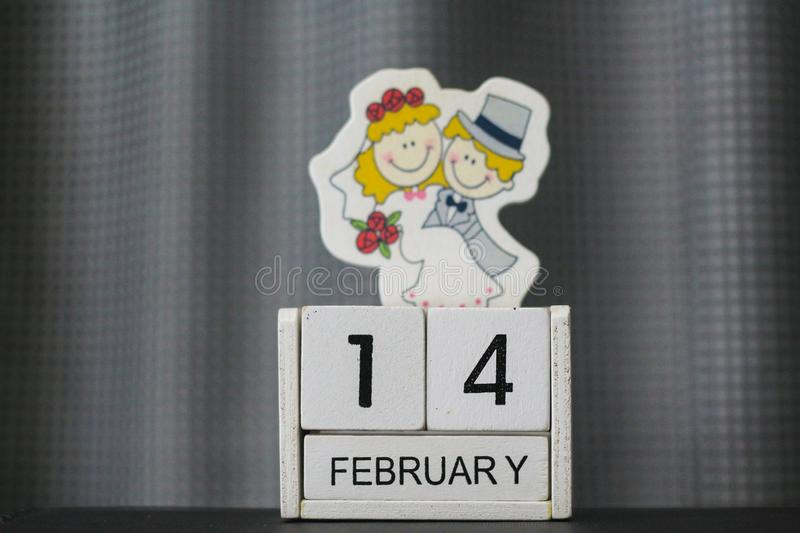 Wooden block calendar for Valentine`s Day stock photos