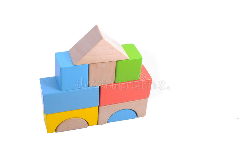 Wooden block. Colorful wooden block shapes on white surface stock image