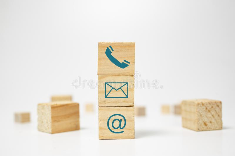 Wooden block cube symbol telephone, email, address. Website page contact us or e-mail marketing concept royalty free stock image