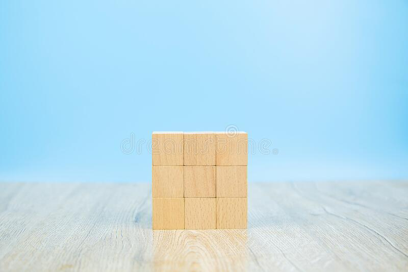 Wooden block toy stacked in square shape without graphics for Business design concept and activity for child foundation practice. Skills stock images