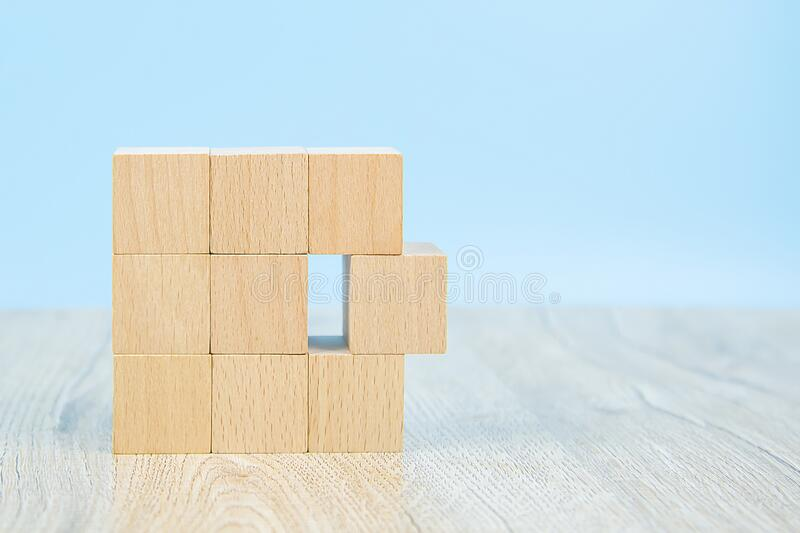 Wooden block toy stacked in square shape without graphics for Business design concept and activity for child foundation practice. Skills royalty free stock image