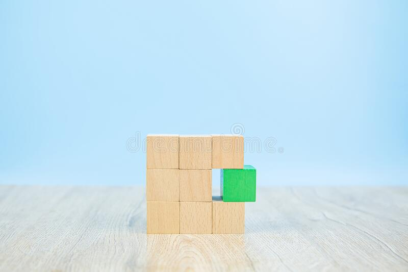 Wooden block toy stacked in square shape without graphics for Business design concept and activity. For child foundation practice skills royalty free stock images