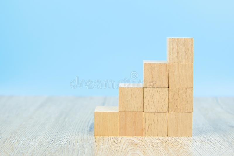 Wooden block toy stacked in triangle shape without graphics for Business design concept and activity stock images