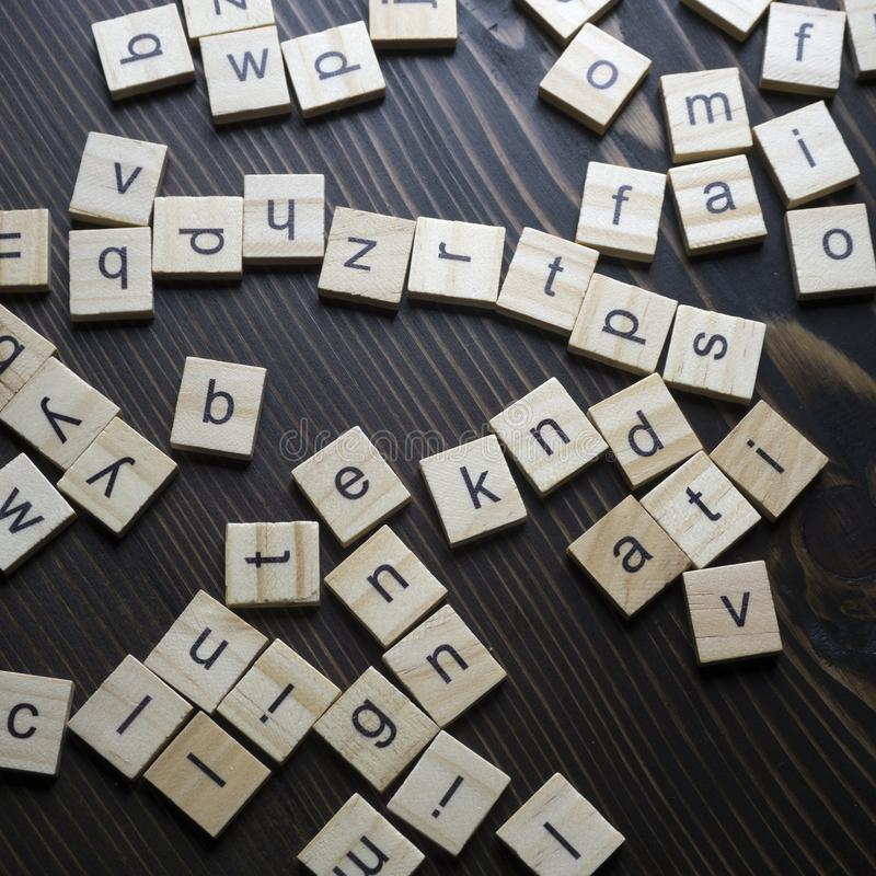Wooden blocks alphabet on the wooden table stock photography