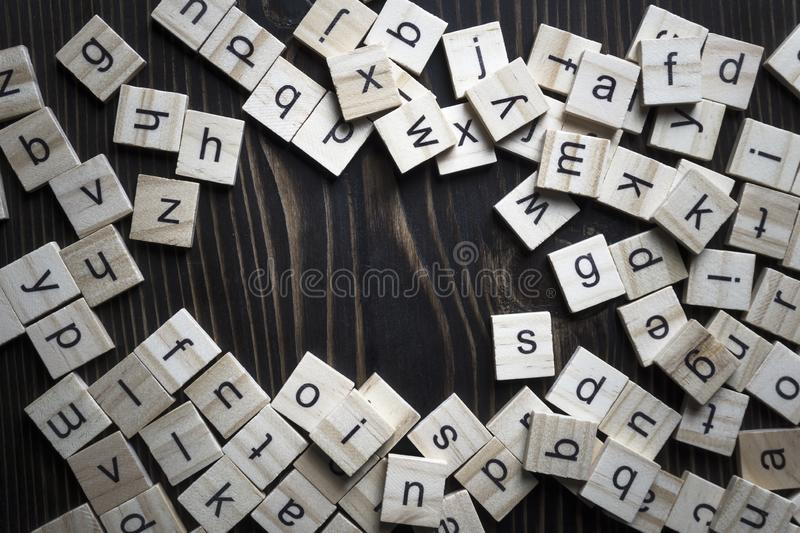 Wooden blocks alphabet on the wooden table royalty free stock photos