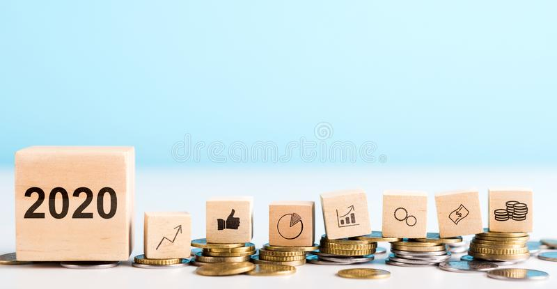 Wooden blocks with coins, dollar, graphs laying on real money royalty free stock photo