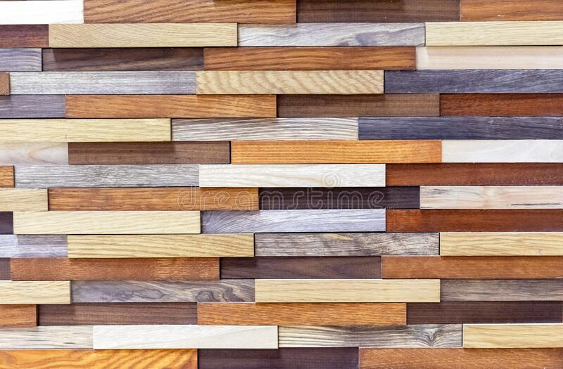Wooden blocks of different colors. Rectangles from different species of wood.  royalty free stock photography