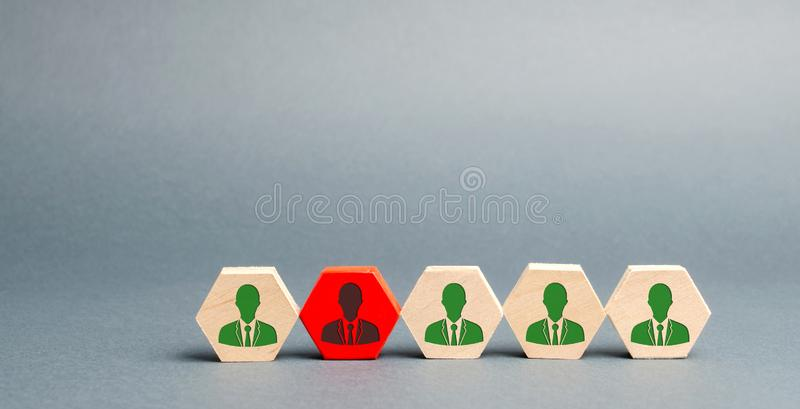 Wooden blocks with the image of workers. The concept of personnel management in the company. Dismissing an employees from a team. Demotion. Bad worker. Staff royalty free stock images