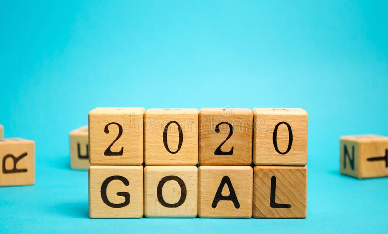 Wooden blocks with the inscription 2020 goal. The concept of achieving business goals. Execution of a business plan. Purposefulness. Planning. Strategy and royalty free stock images