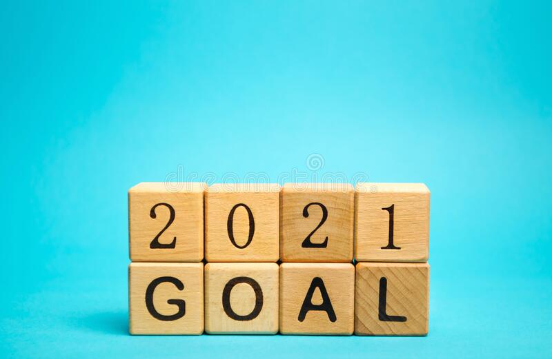 Wooden blocks with the inscription 2021 goal. The concept of achieving business goals. Execution of a business plan. Purposefulness. Planning. Strategy and stock image