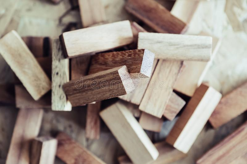 Wooden blocks of Jenga or Tumble tower game. Closeup image of wooden blocks of Jenga or Tumble tower game royalty free stock images