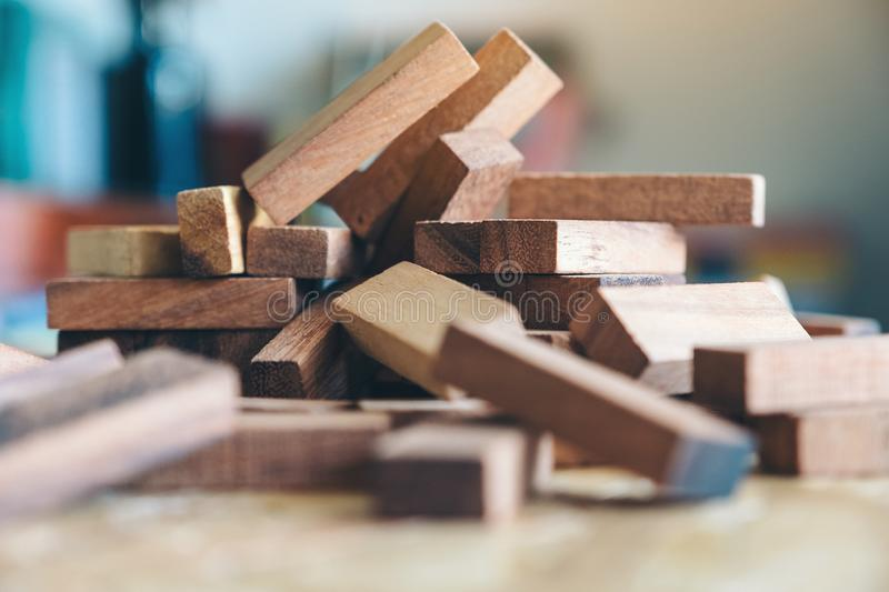 Wooden blocks of Jenga or Tumble tower game. Closeup image of wooden blocks of Jenga or Tumble tower game royalty free stock image