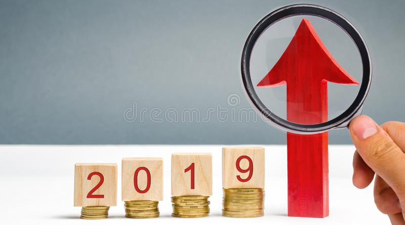 Wooden blocks 2019 and red arrow up. Successful and reliable business. Good prospect. Saving money and financial planning. Tax royalty free stock photo